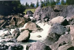 [Photograph]: Water swirling through rocks on the Middle Fork Eel River.