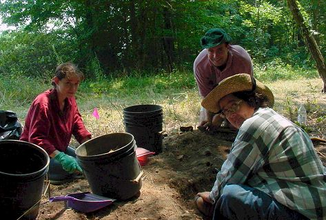 volunteers and staff from Indiana State Museum work at the Lick Creek Settlement.