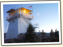 A photograph of a fire lookout in the moon light. Credit: B. Douglas Jensen, August 10, 2005.