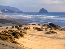 photo looking south to Haystack Rock from beach at Sand Lake