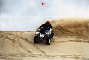 photo of ohv carving sand on dune