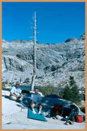 [Photo]:  Ben and Roger Verseman settle down to rest at Twin Lakes in Desolation Wilderness.  2001 Amy L. Reid, USFS.