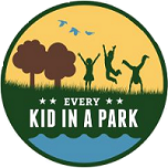 Every kid in a park circle logo