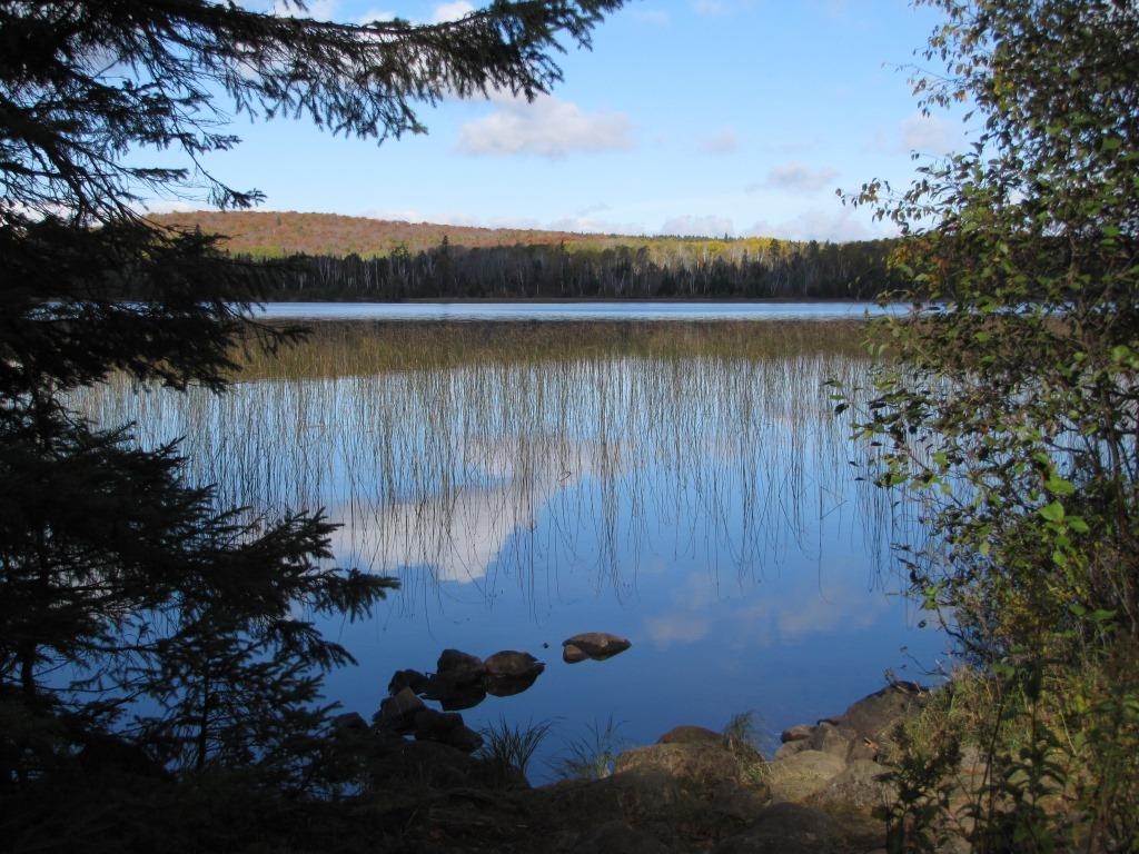 A view from Toohey Lake Campground of fall across the lake.