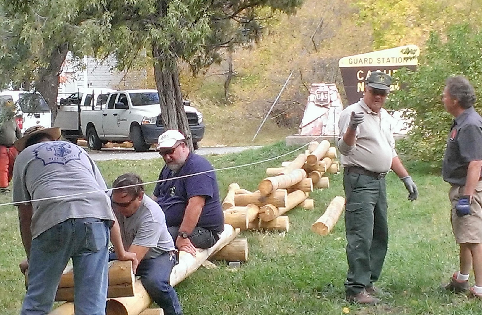 Photo of volunteers working on new pole fence.
