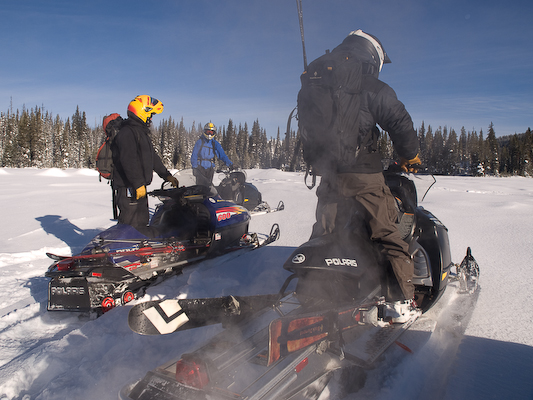 Photo of snowmobilers on machines