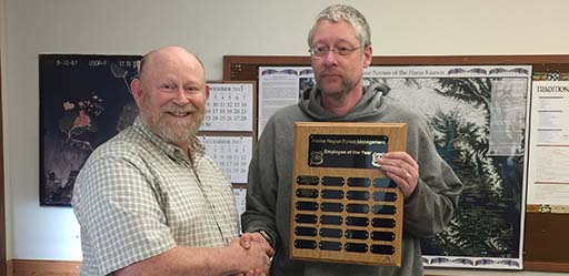 Hoonah District Ranger, Art Burbank, presents Chris Budke with the 2015 Forest Management Employee of the Year Award.