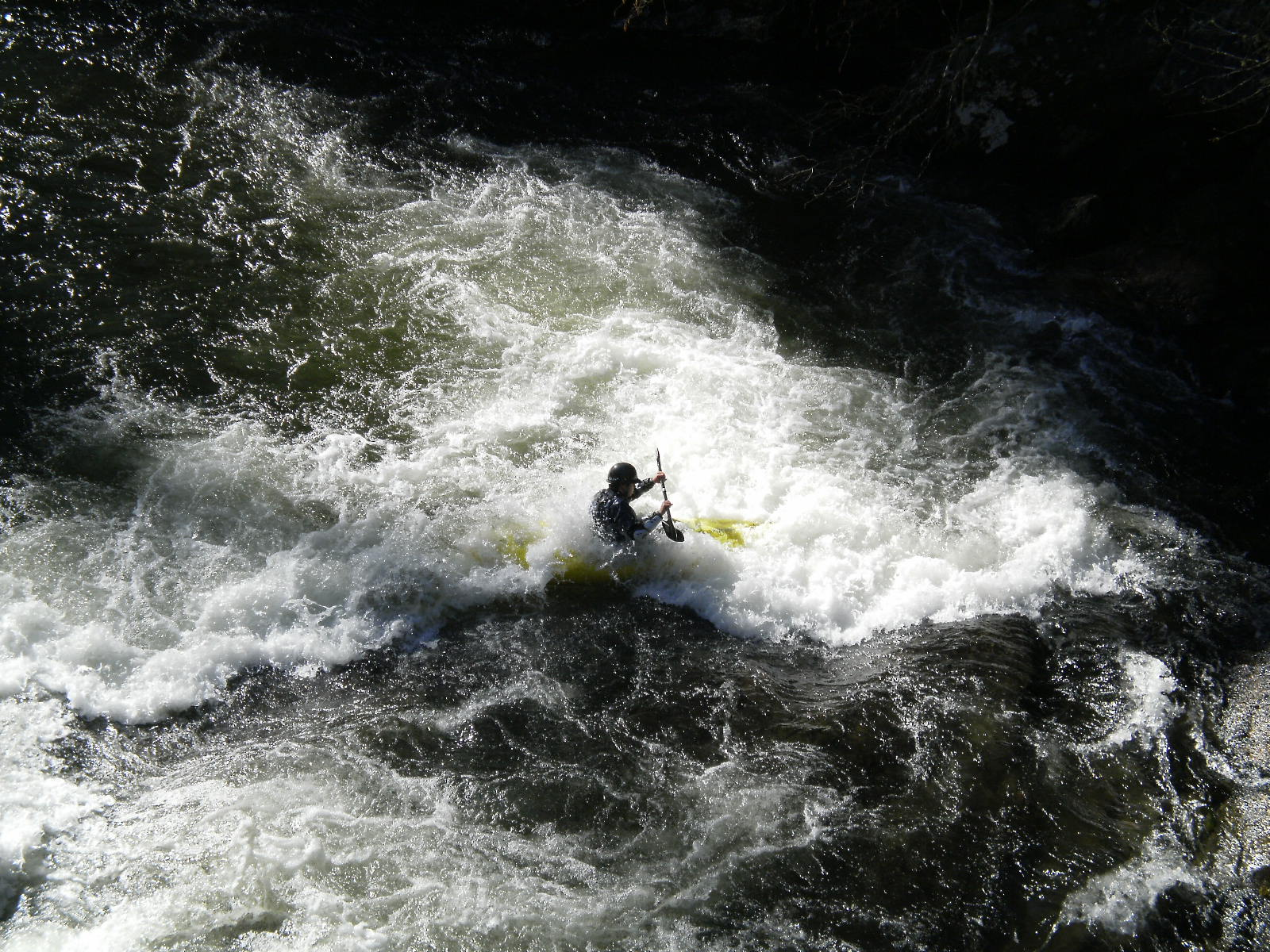 Boater paddling kayak on the Chattooga WSR