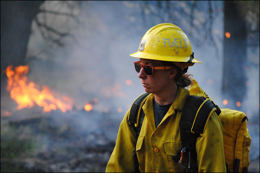 A photo of a woman working on a wildfire