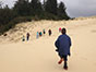 School children hike across the Oregon Dunes