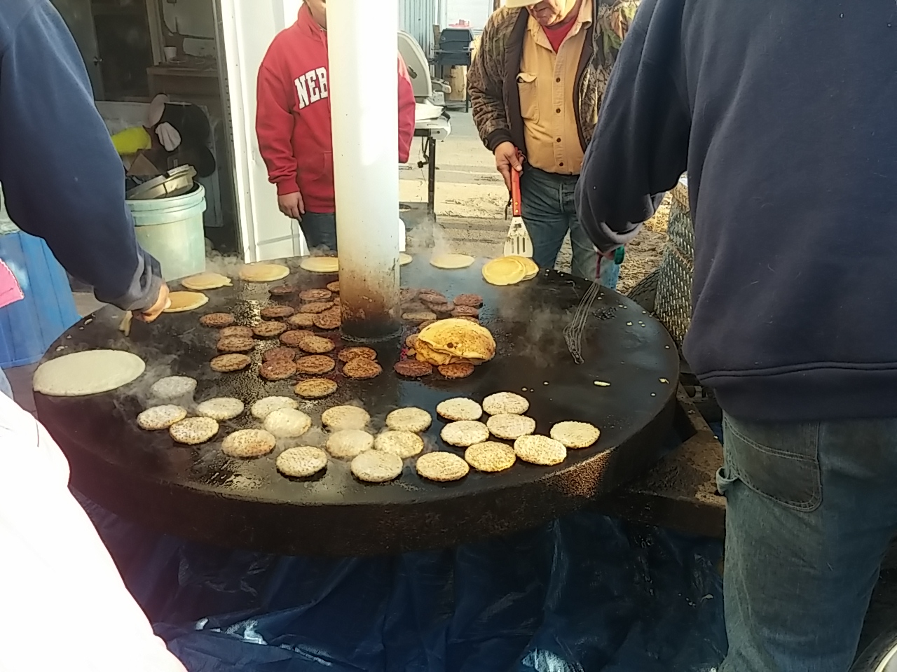 A homemade, large rotating grill for the pancake feed.