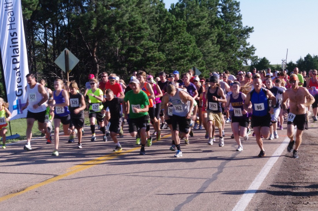 Runners take off at the start of the annual Scott Trot.