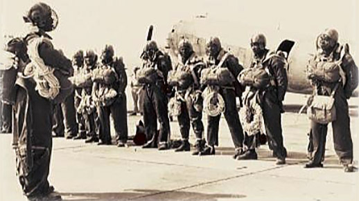 African american smokejumpers in full gear standing in a line in the 1945.