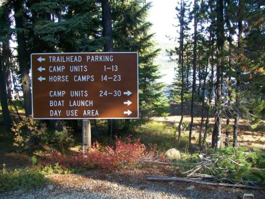 Trailhead parking information sign in the campground