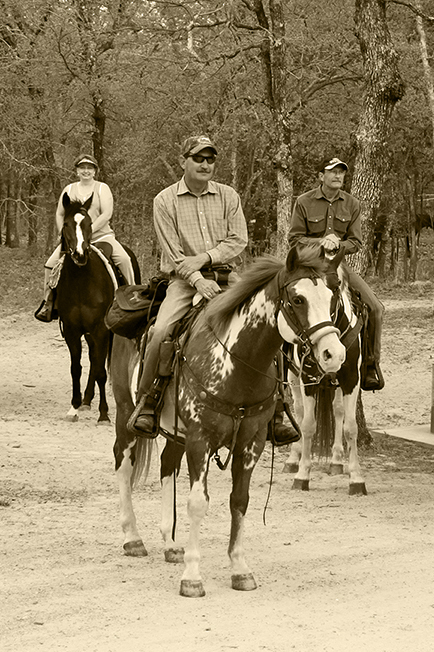 Horseback riders relax during a trail ride on the Caddo National Grasslands.