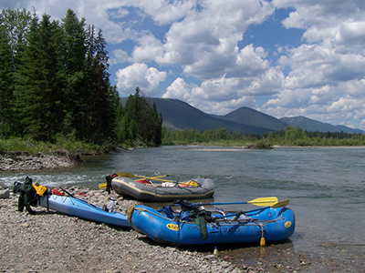 River rafts on the bank along the North Fork of the Flathead