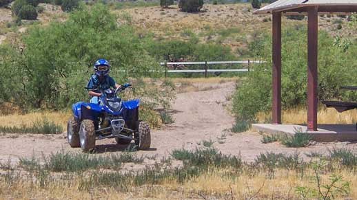Child riding ATV in the tot lot at Hayfield Draw OHV Area