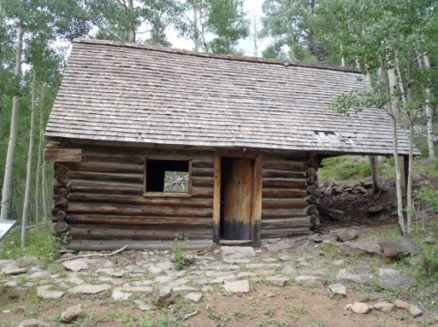 Photo of a guard station with no windows that is looking a little run down.