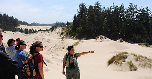 Author Dina Pavlis leads tours of the Oregon Dunes