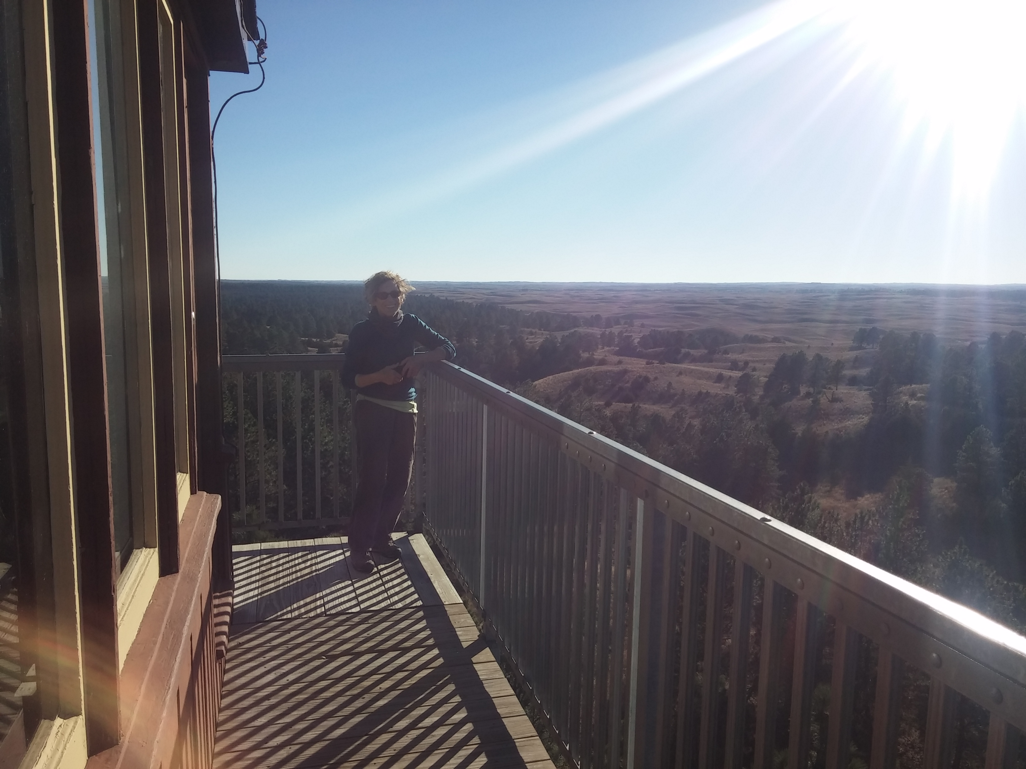 A woman on the platform of the Scott Lookout Tower.
