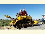 Mr. & Mrs. Wolfskill behind 1945 yellow Trail Beetle Tractor