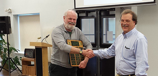 Jeff Barnard receiving the Alaska Region 2015 Silviculturist of the Year award from Dave Harris.