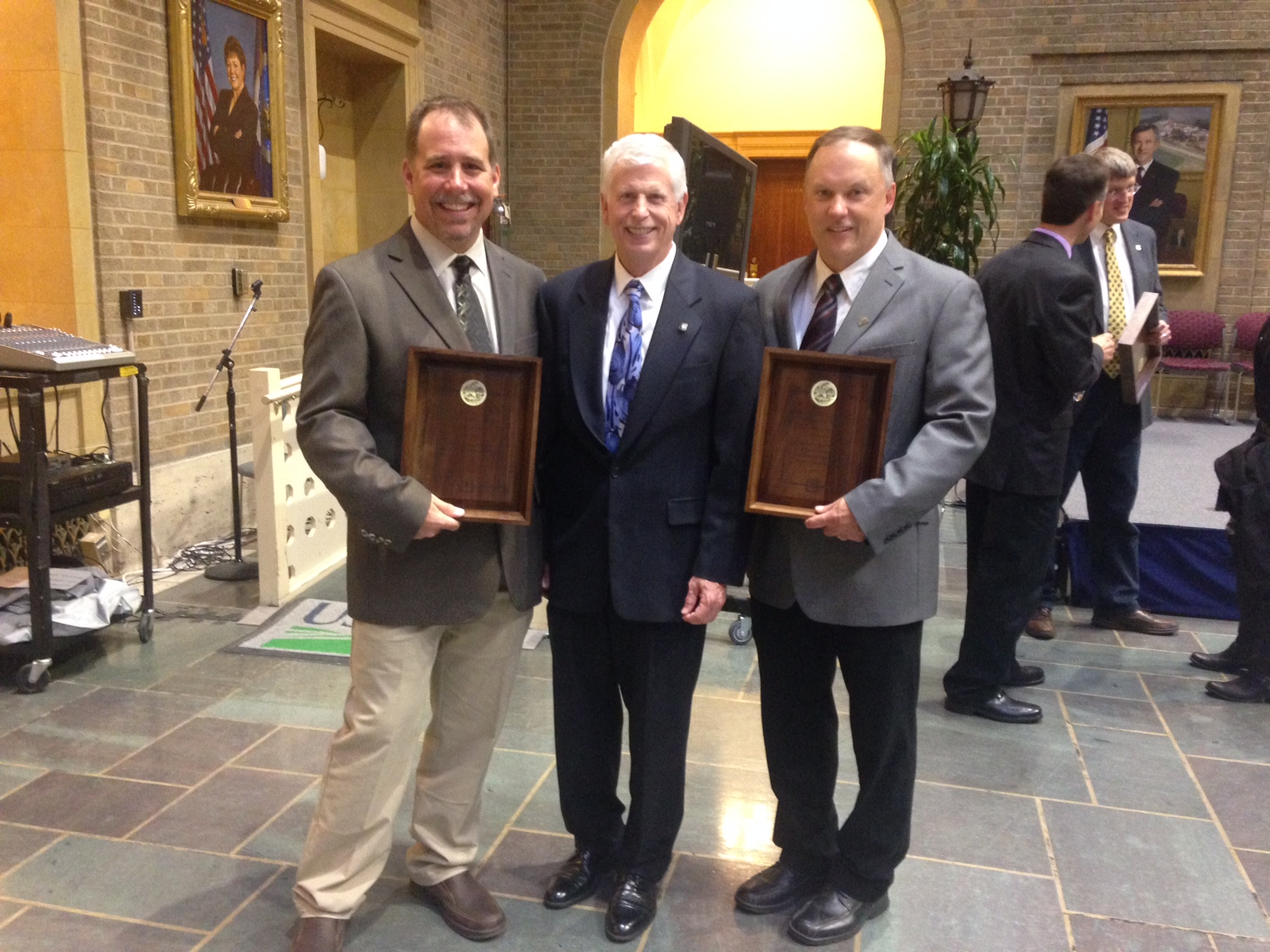 Todd Tisler and Jon Hodgson receiving award from the Chief of the Forest Service