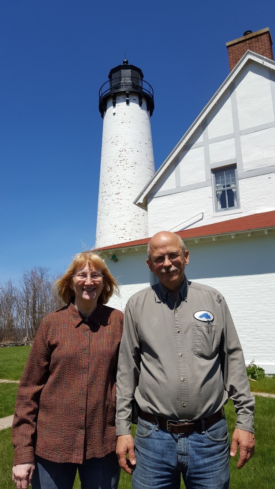 Peg and Doug Hoort in front of Point Iroquois Light House