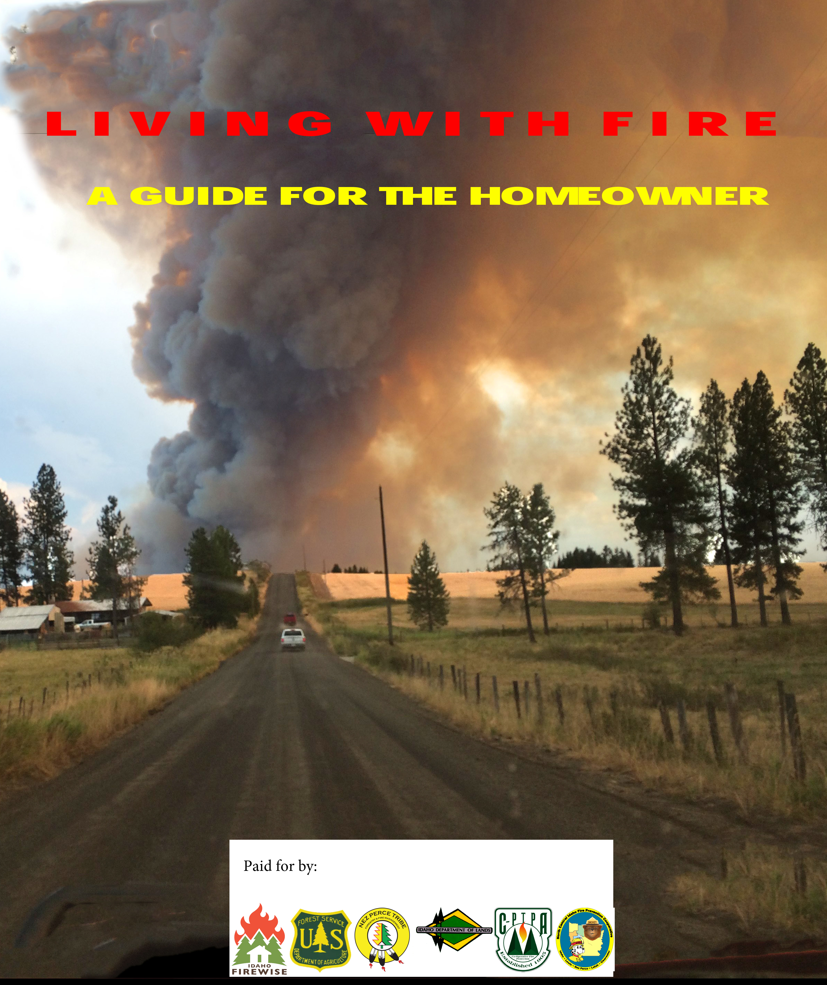 Cover photo depicts a country road with vehicle headed towards a wildfire.