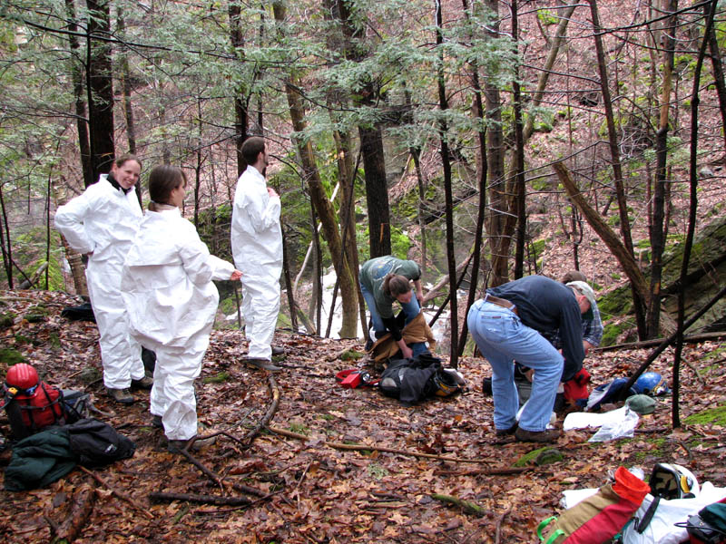 people wearing white haz mat suits preparing to enter cave with White Nose Syndrome