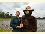 Bob Blasi receives his award from Smokey Bear.