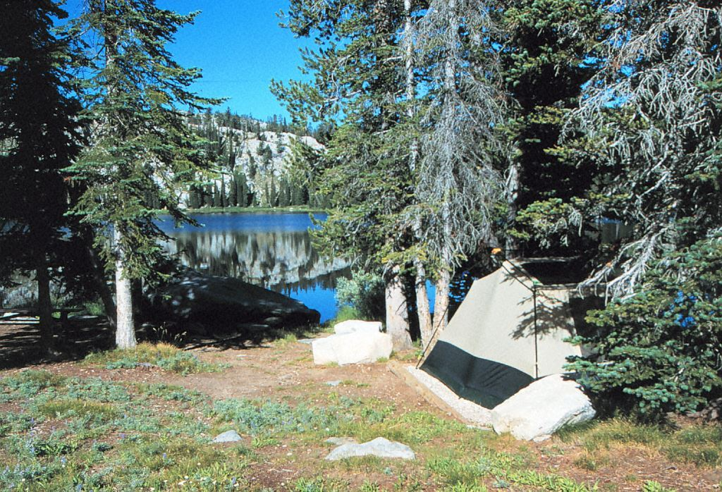 Photo of tent next to lake in Trinities