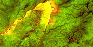 Photo of a map with a red line around the fire border and a bright yellow showing the intense heat.