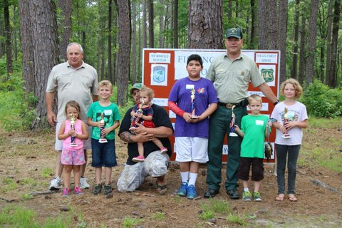 Winners from each age class with trophies at 2016 Winn District Fishing Derby