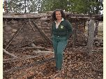 Kaibab National Forest archaeologist Margaret Hangan stands in front of a prehistoric ruin.