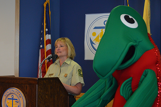 Sasha salmon poses with a USFS official at a podium