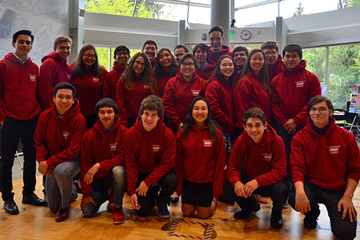 A group of young people pose in red ANSEP sweatshirts
