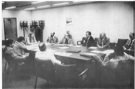 Historic photo of a meeting of the early Steering Committee and Study Team