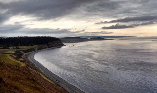 An early fall storm colors the sky over the PNT at Ebey's Landing