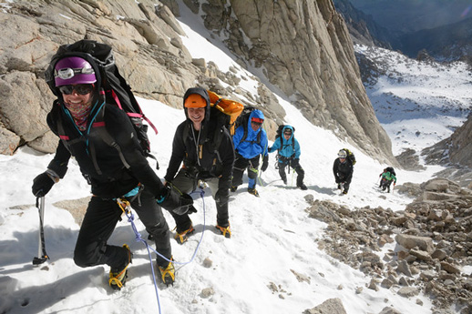 Guides teach guests snow climbing skills.
