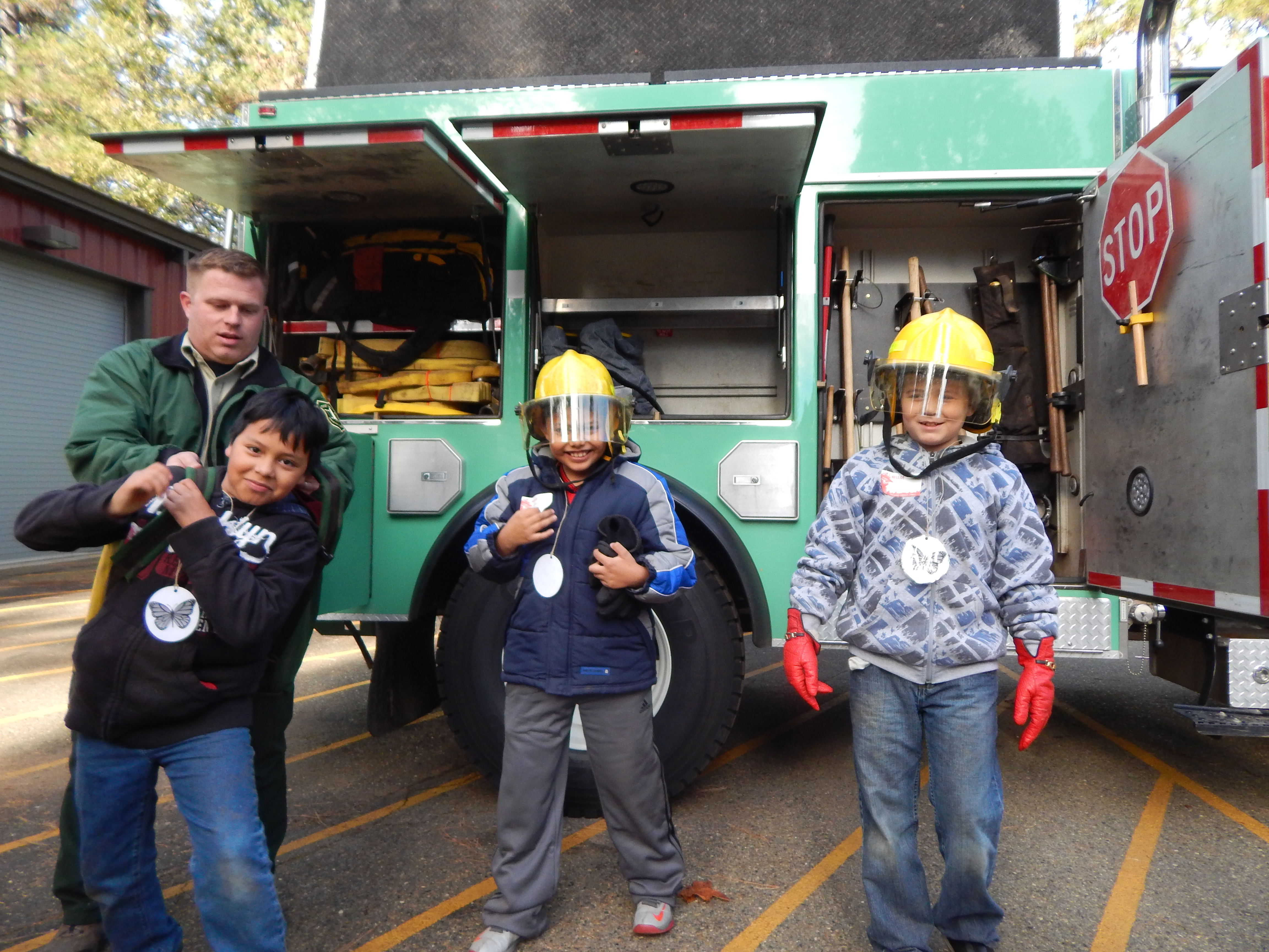 kids wear firefighting gear