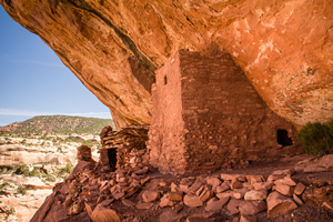 Photo of an old Indian ruin that was was used for shelter under a rock cliff.