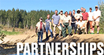 A link that takes you to information about partnerships on the Siuslaw National Forest. IMAGE:A group of partners at a replaced culvert