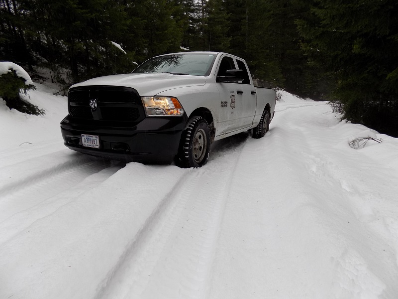 Forest service vehicle on a snowy road