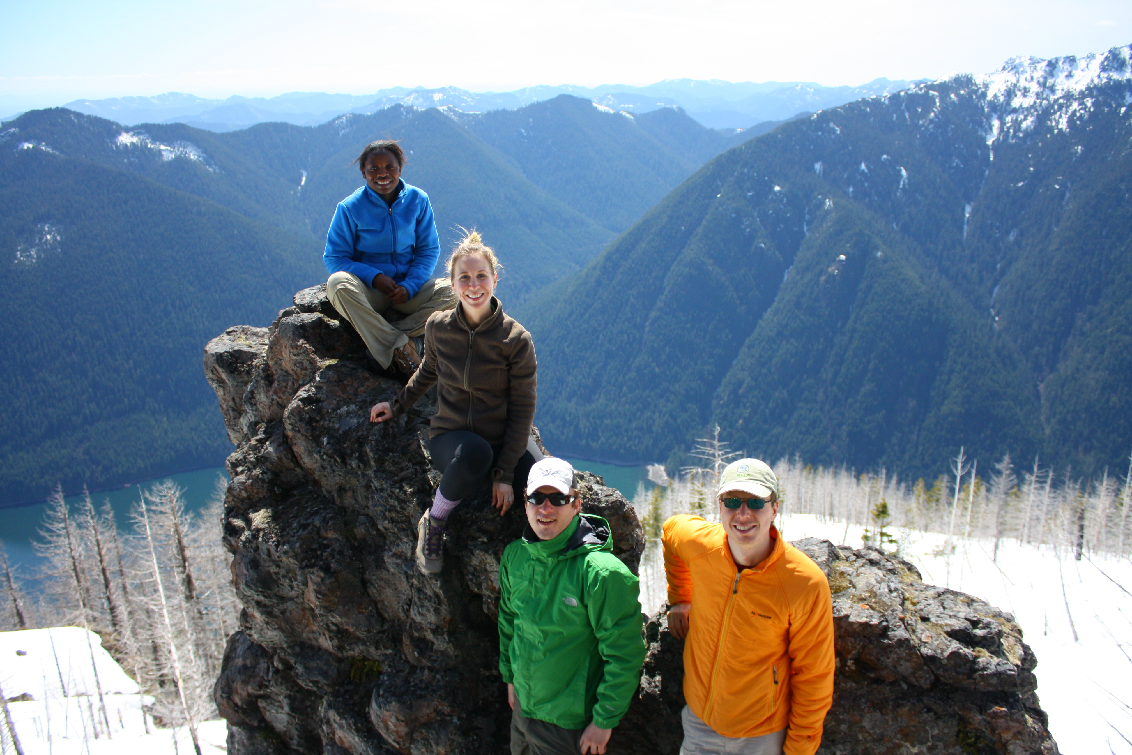 Hikers on top of Mt Rose over Lake Cushman