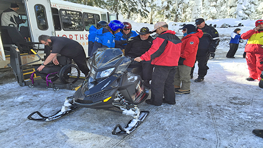 Military Sports Camp participant on board snowmobile gets ready to depart.