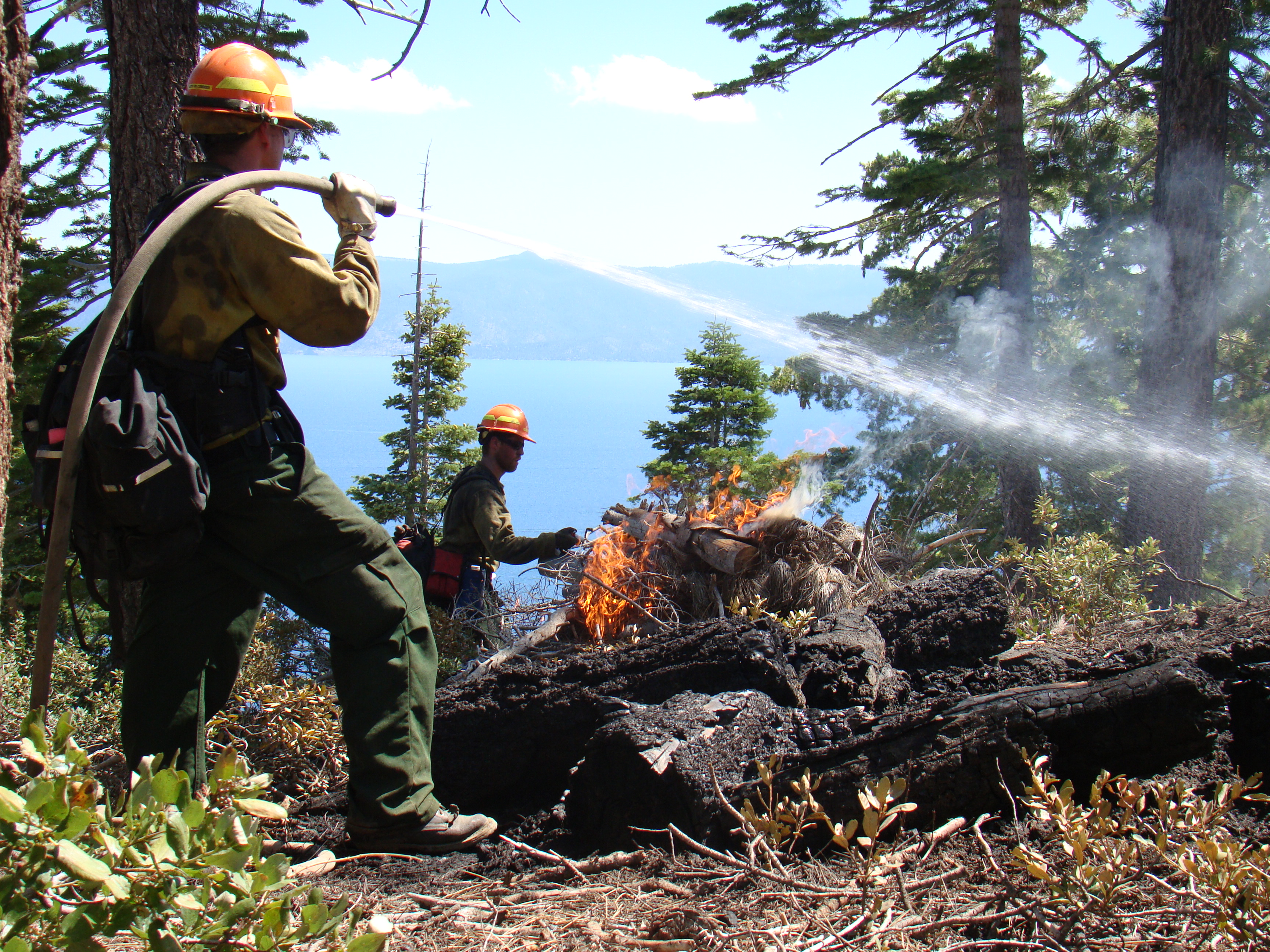 Crew members conduct prescribed fire operations above Lake Tahoe.