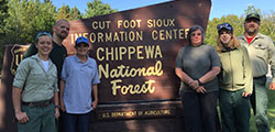 Six volunteers in front of the Cut Foot Sioux Information Center