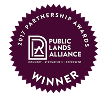A badger that reads Public Lands Alliance 2017 Partnership Awards Winner