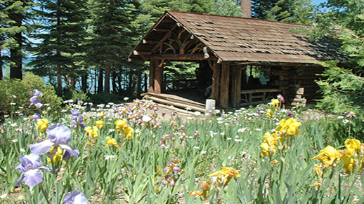 The Honeymoon Cabin at Tallac Historic Site sits alongside the south shore of Lake Tahoe.